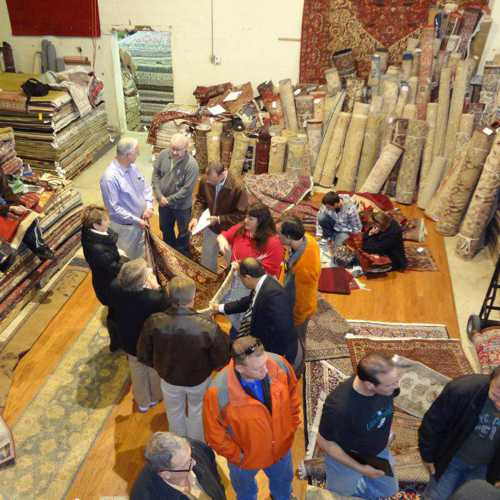 Overhead view of rug class attendees